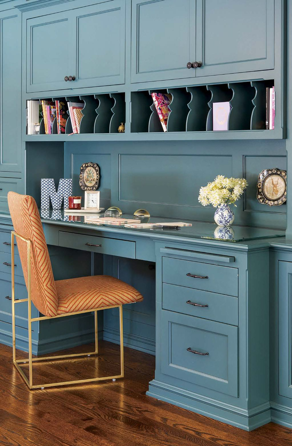 Custom made built-in desk and wrapping station in a bold shade of aqua.
