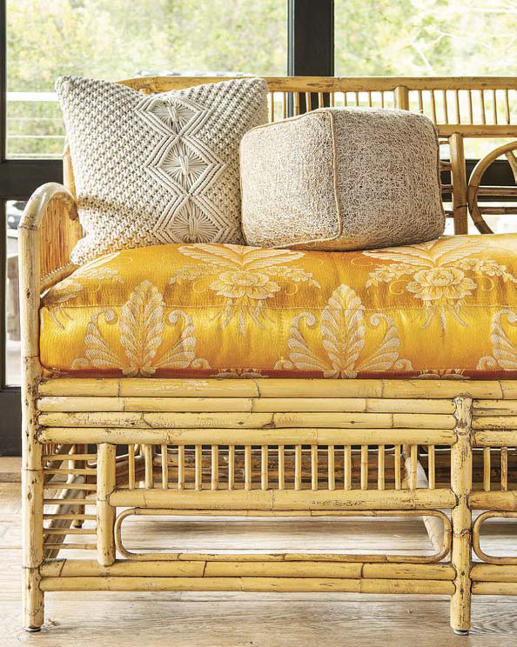 Rattan styled dining sofa with a 1940s satin cushion in butterscotch.