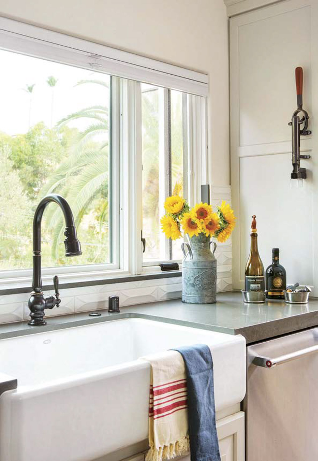 kitchen remodel with beautiful white farmhouse kitchen sink overlooking a large wide window with a view.