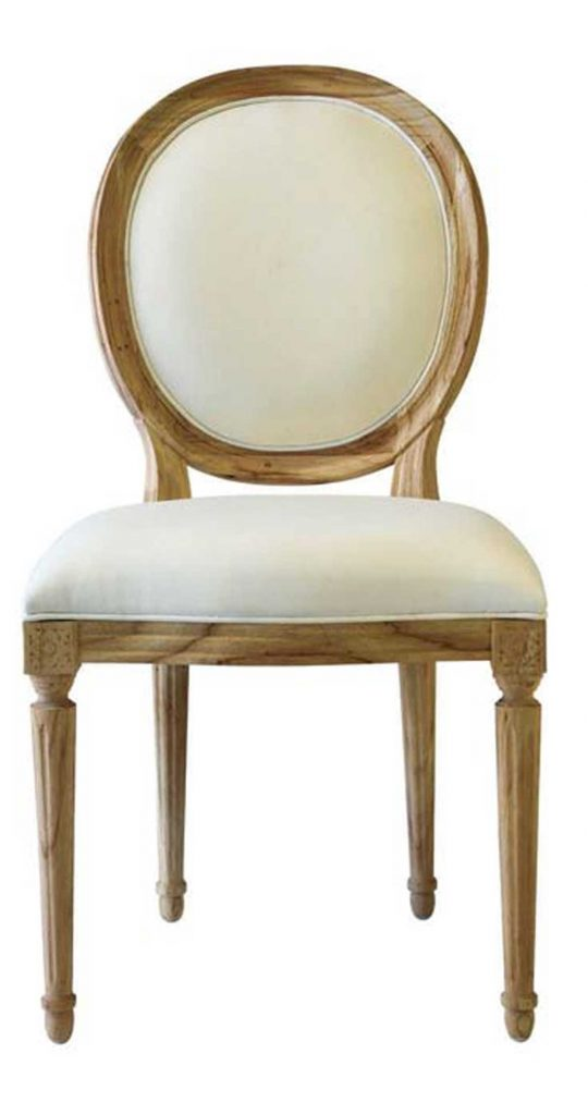 Round backed dining chair carved wood with cream colored upholstery.