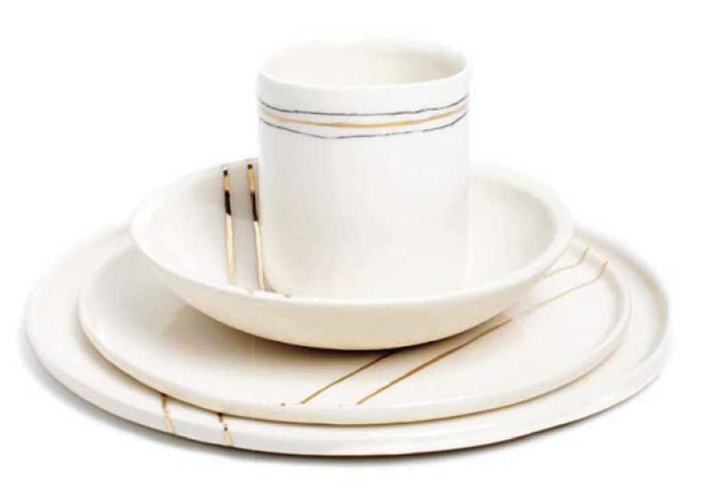 Stacked cream dining set with thin gold accent lines.