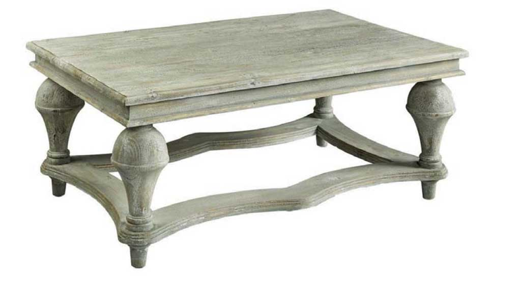 Soft gray rubbed pine finish on a low coffee table with turned legs.