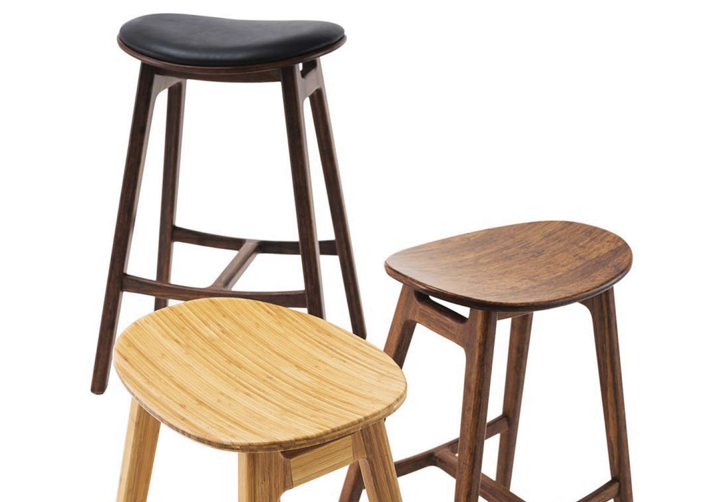 Bamboo barstools in three varying shades of wood.