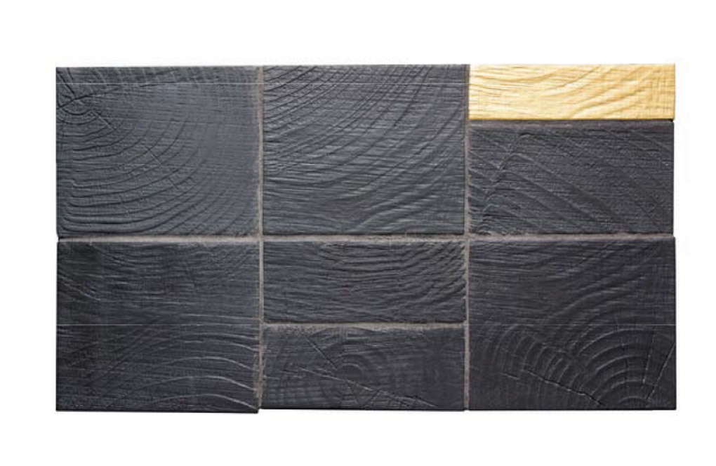 Rustic country style tile sample in a deep gray with woodgrain look.
