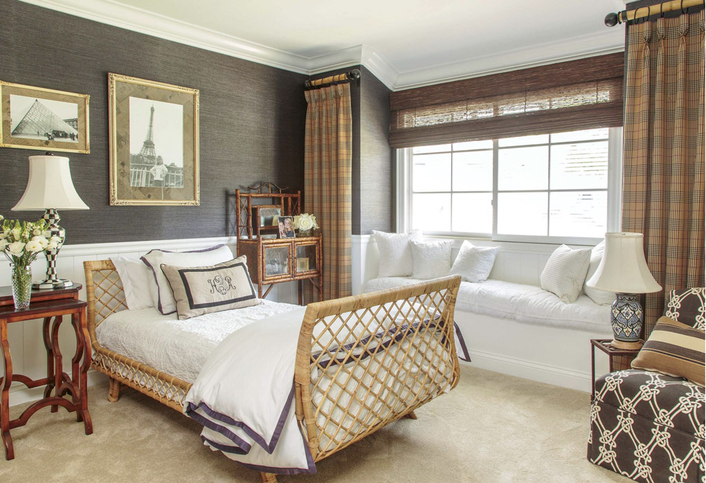 A welcoming home with a guest bedroom with brown deep tones and woven and rattan styled furnishings.