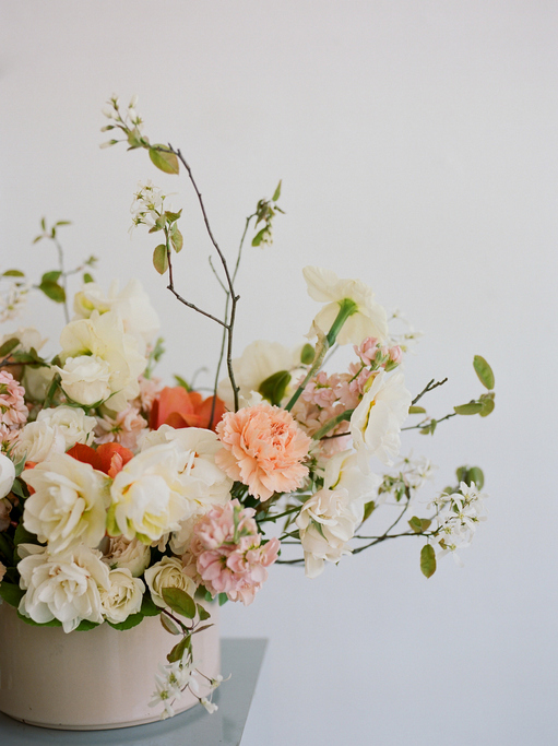 Modern floral design in neutral tones with long whisps.