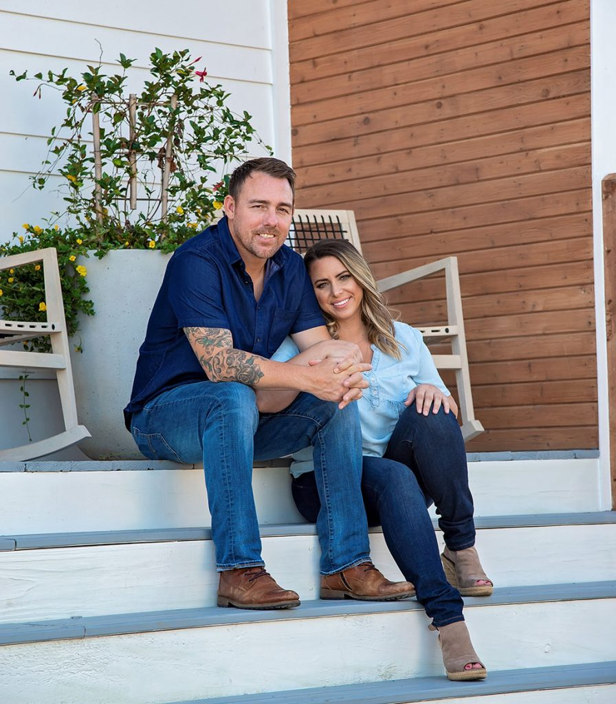 Linsday and JJ Morris on the steps of one of their Scissortail Homes builds.