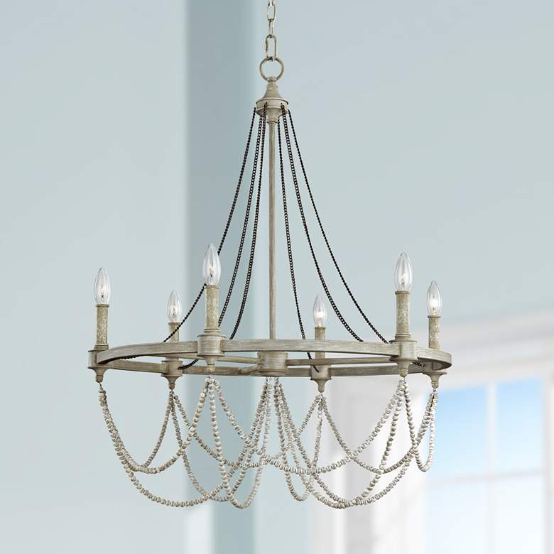 Cottage styled chandelier with exposed bulbs and beaded detailing.