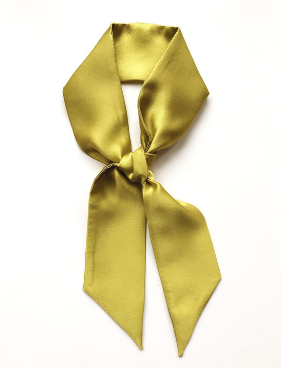 Chartreuse silk neckerchief, tied in a loop.
