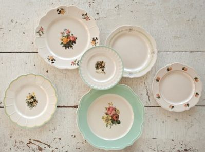 Vintage styled dishes in floral green and cream colors.