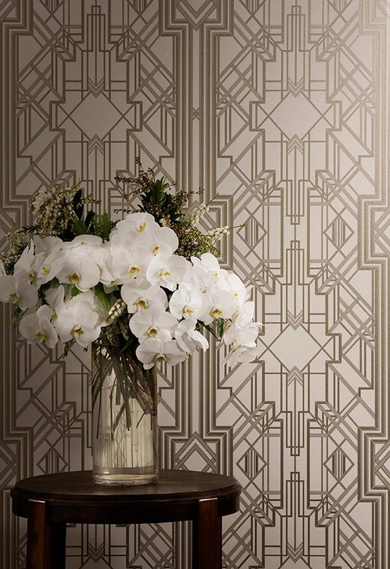 Art Deco metallic foiled wallpaper with a vase of large white flowers.