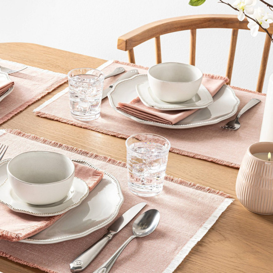 Hearth & Hand spring collection of rode gold colored placemats and napkins displayed for dining.