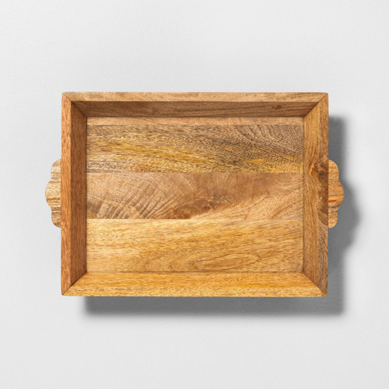 Carved wooden rectangular serving tray.