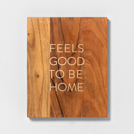 """Wooden wall sign that reads, """"feels good to be home."""""""