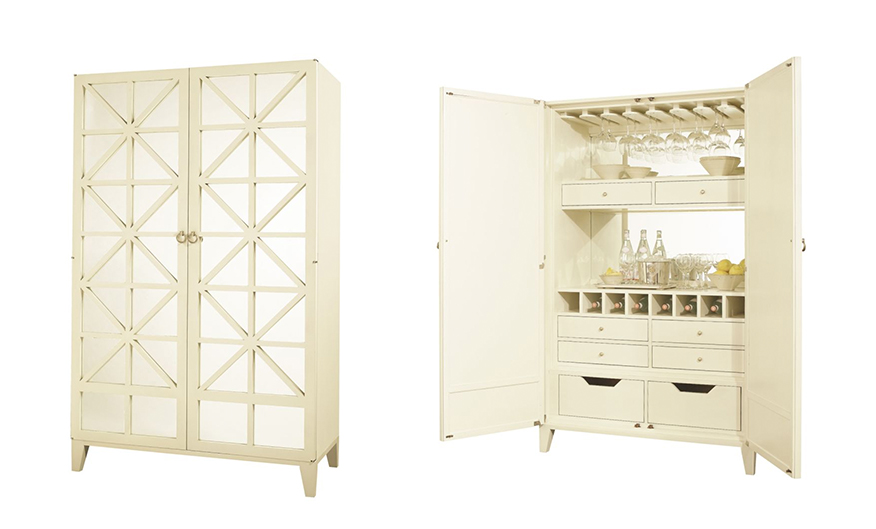 Cream colored large bar cabinet with antique glass paneled doors.
