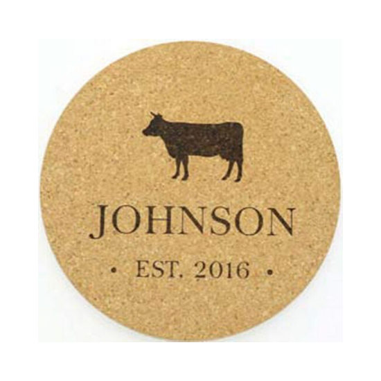 Farmhouse kitchen decor customized cork trivet with last name and a cow silhouette.