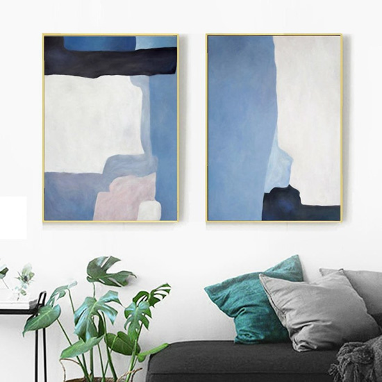 Large blue abstract watercolor wall art in gold frames.