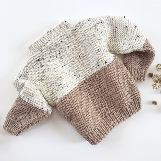 Speckled cream and taupe color blocked kids sweater.