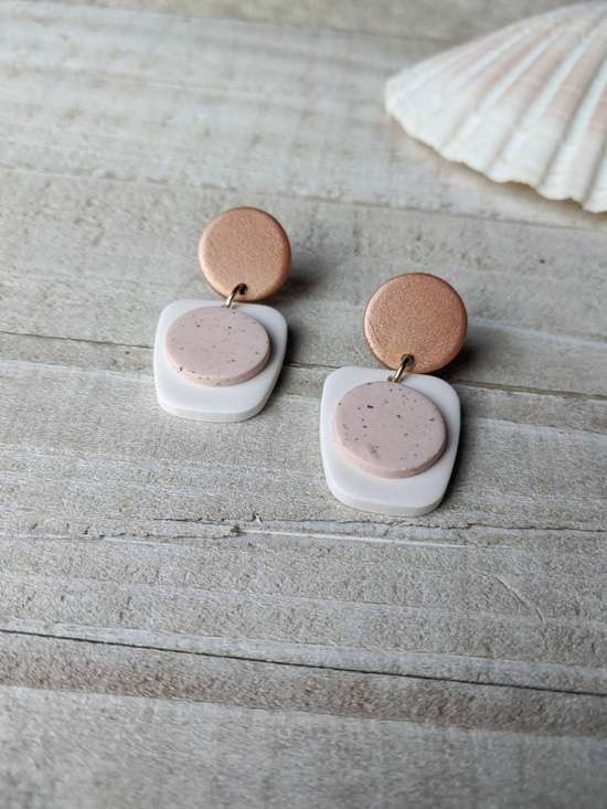 Modern geometric two toned earrings in shades of blush and gold.