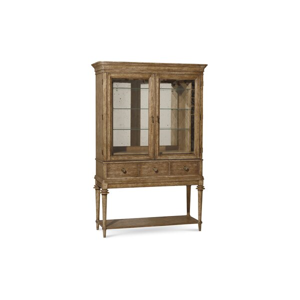Antique cellarette inspired bar cabinet with mirrored backing.