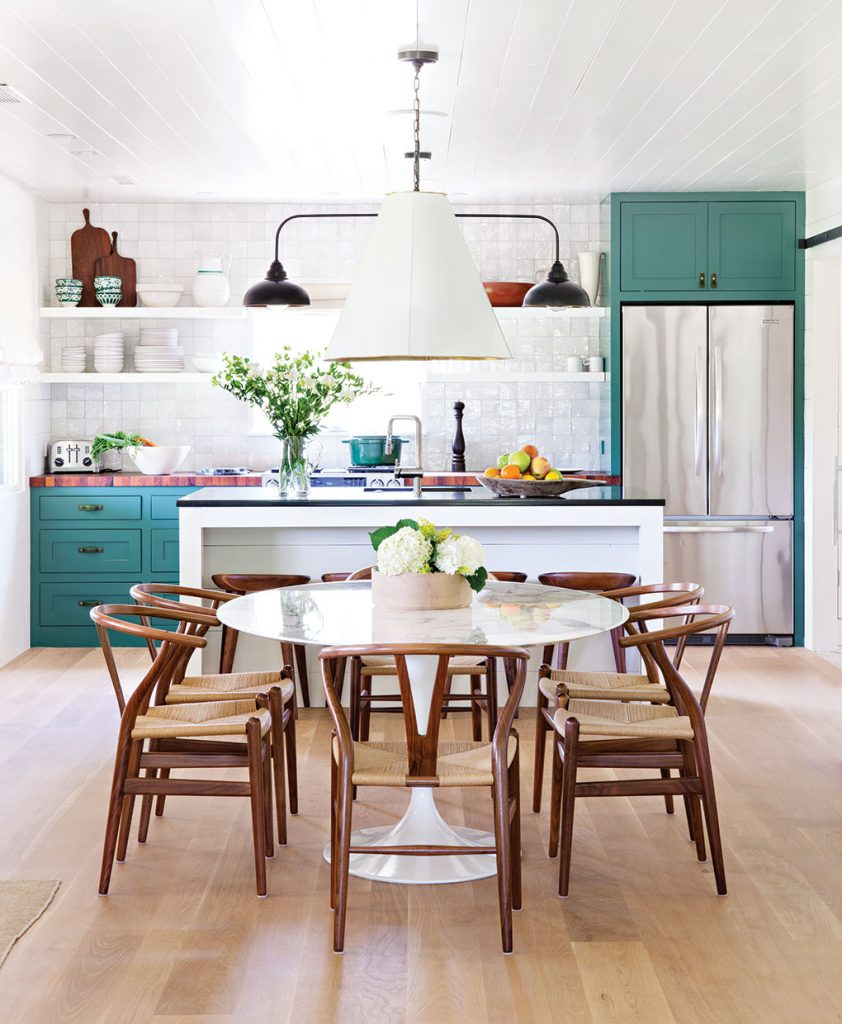 "The motto ""A Place for Everything and Everything In It's Place"" really rings true when it comes to paring back. Christina Simon of Mark Ashby Design created this open plan kitchen/dining room in Austin, Texas so that there would be room for the essentials and those essentials would make up the design. Photo by Bret Gum."
