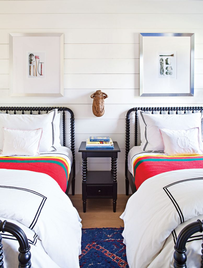 For this kid's room designed by Christina Simon of Mark Ashby Design, a simple shared nightstand is perfectly functional in a small space and yet keep clutter at bay. Photo by Bret Gum.