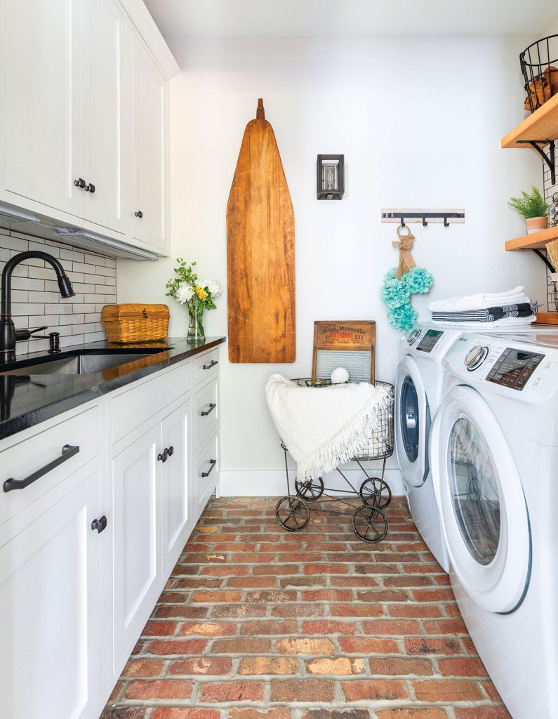 Project House laundry rom with cherokee brick flooring and a vintage ironing board and laundry basket // whole house deep clean