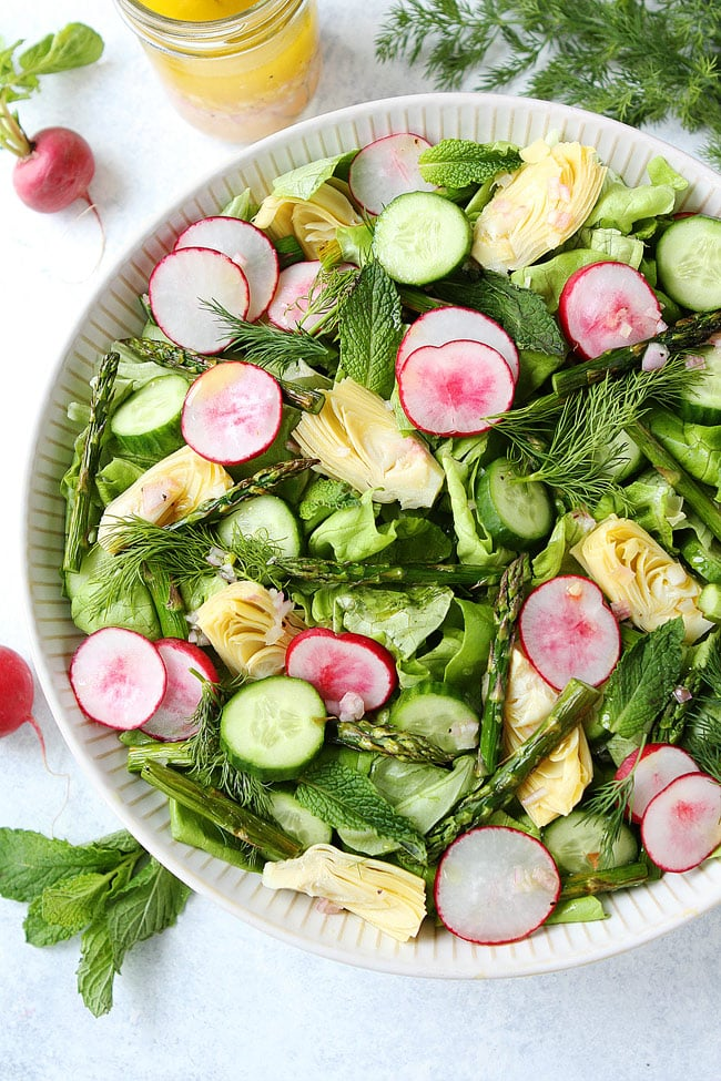 spring cobb salad with artichokes, radish, asparagus fresh dill, and arthichoke hearts