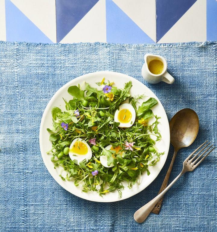 mixed green and tossed herb salad with peas and soft boiled eggs