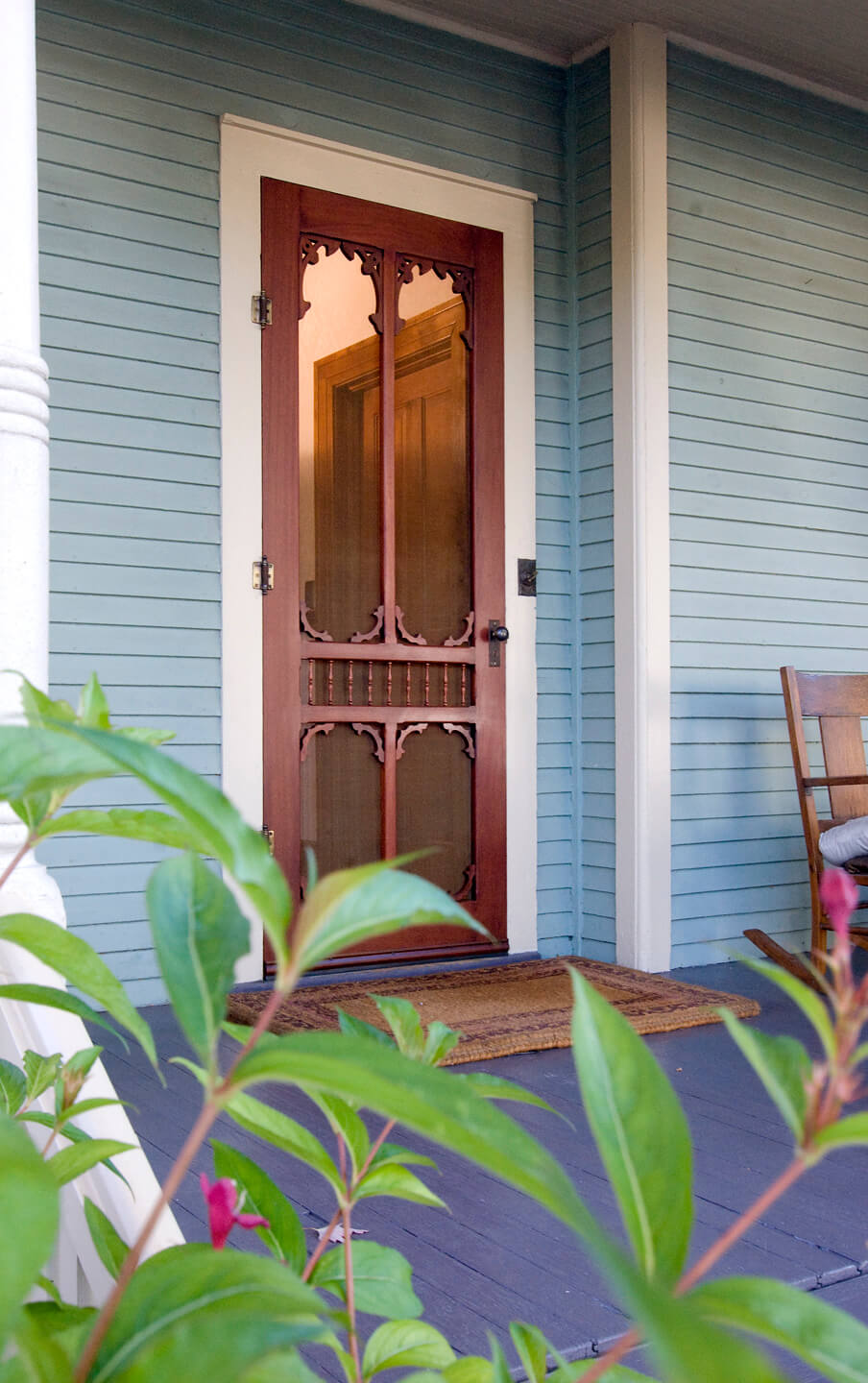 Brown front door with historic details