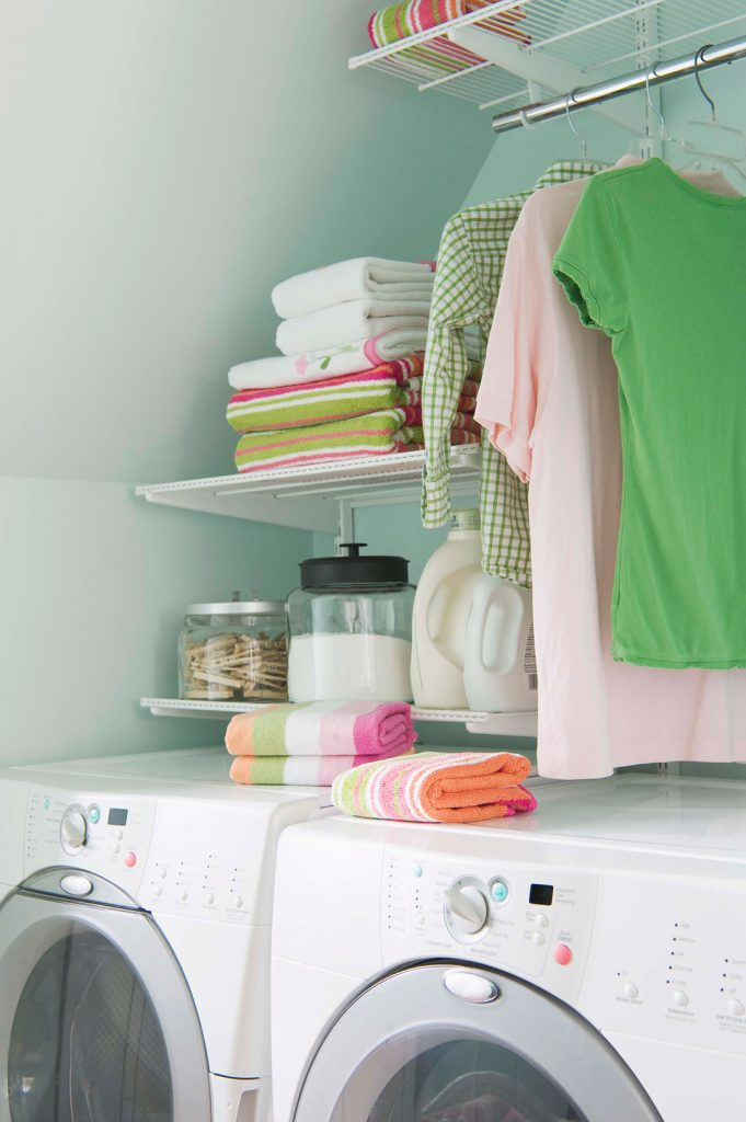 laundry and mudroom design with open shelves above the machines