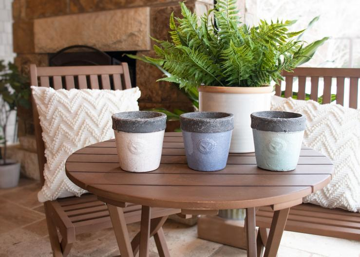 Set of three vintage pot candles on tabletop from Patio Essentials
