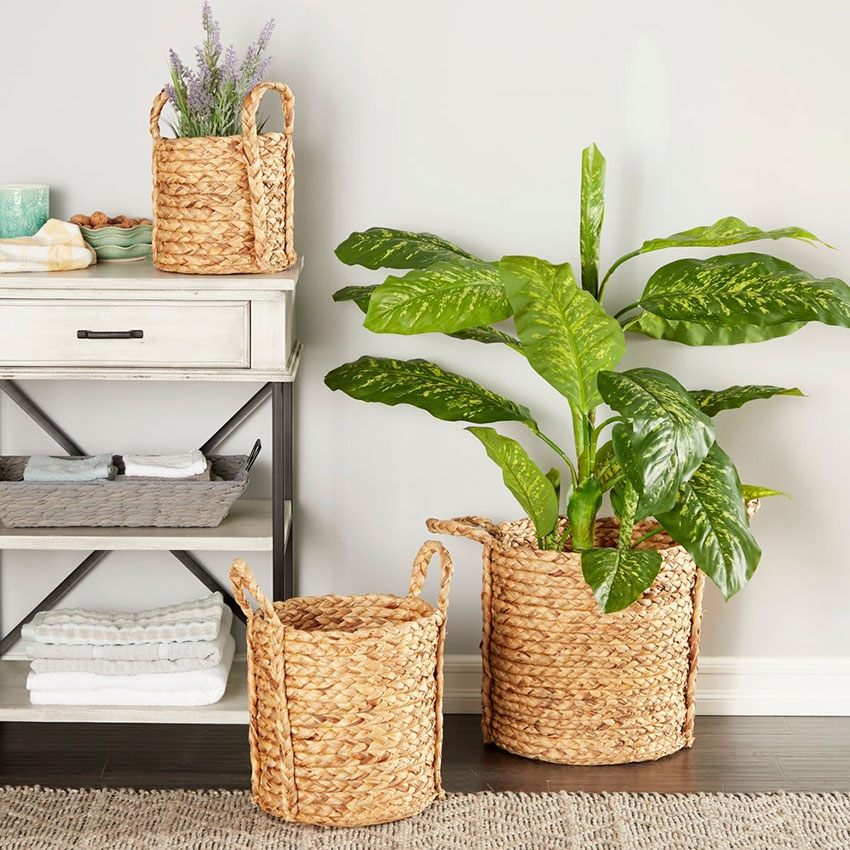 seagrass handled baskets used as planters near a cottage style entry table