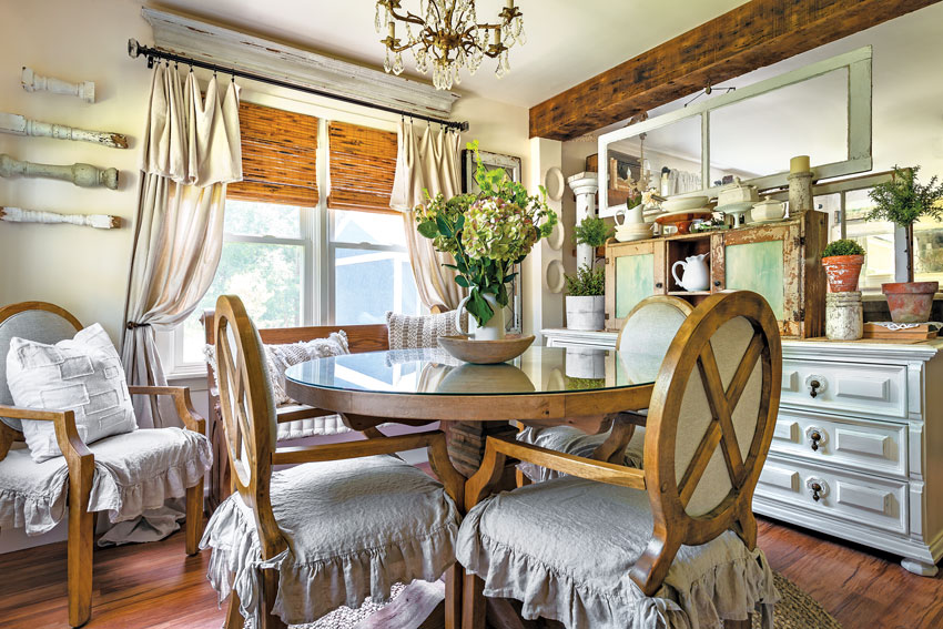 Vintage spindles, cabinets and window frames give this dining room inimitable texture