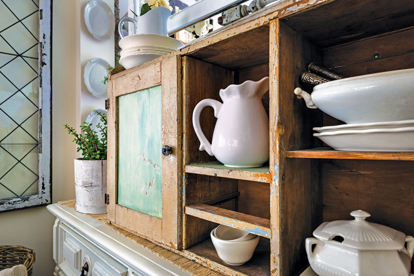 wood cabinet full of ironstone pieces