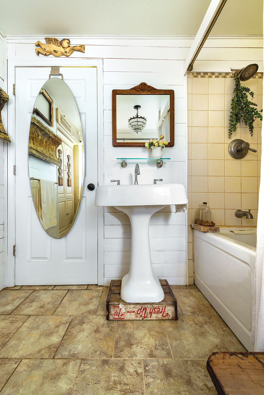 Small bathroom of the a cozy country cottage in white and tan color scheme