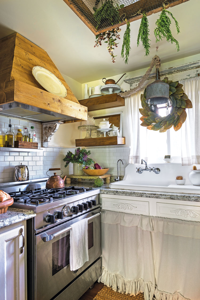 a custom-made hood and a farmhouse sink in small charming cottage kitchen