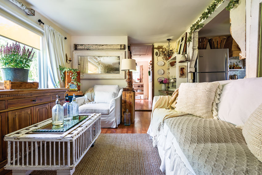 Living room of a cozy country cottage in neutral colors