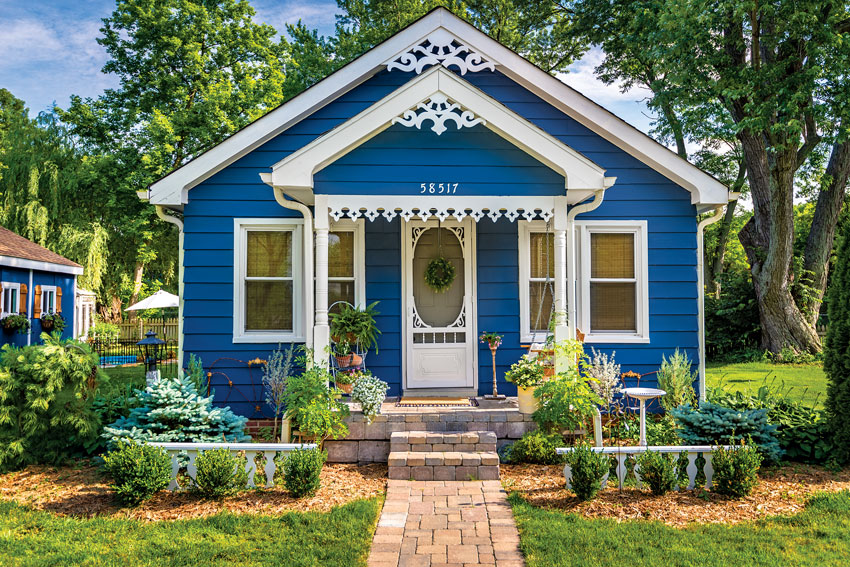 Small country cottage in bright blue paint
