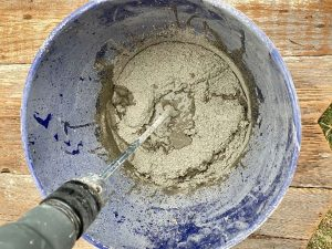 Cement for cement pumpkin bowl is mixed in a separate bucket.