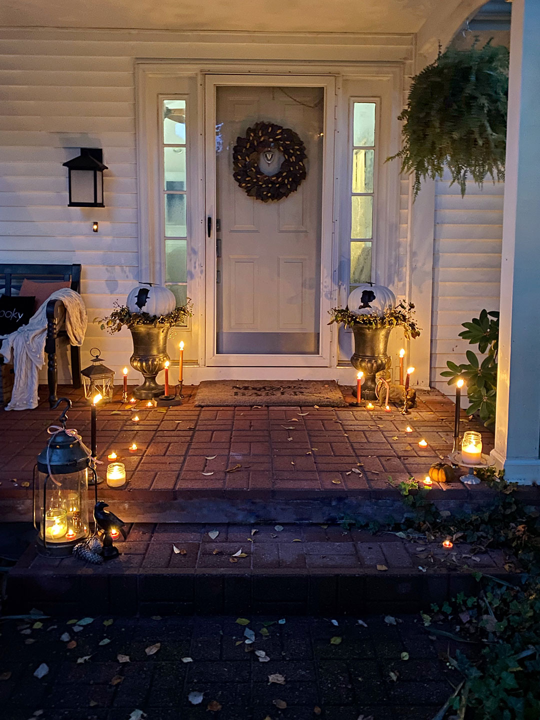 Halloween porch decor with custom no-cut pumpkins painted with vintage-stlye silhouettes