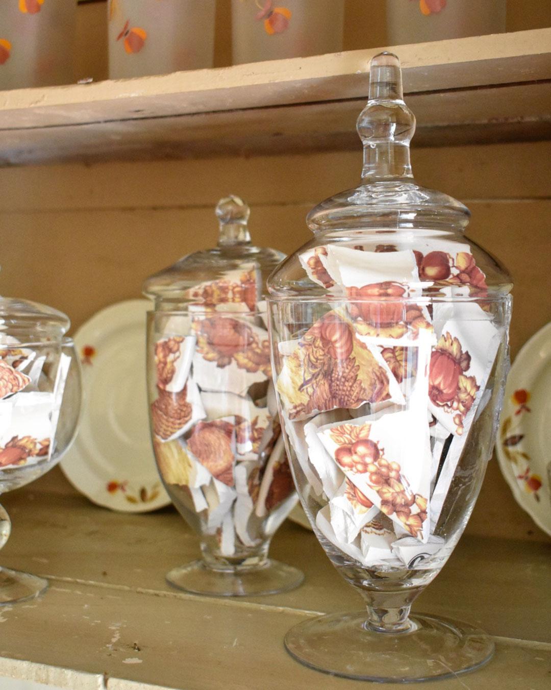 Apothecary jars full of broken plate shards