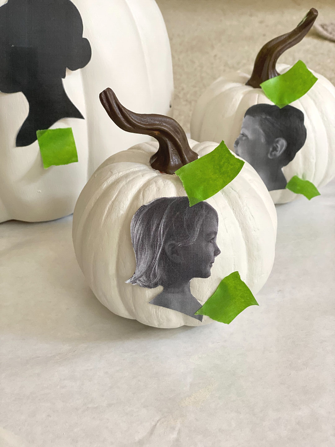 Side portrait taped to pumpkin to create outline for silhouette