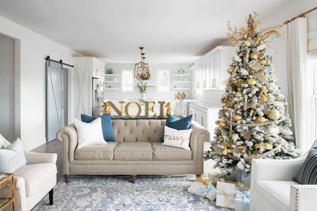 Neutral and blue living room decorated for christmas