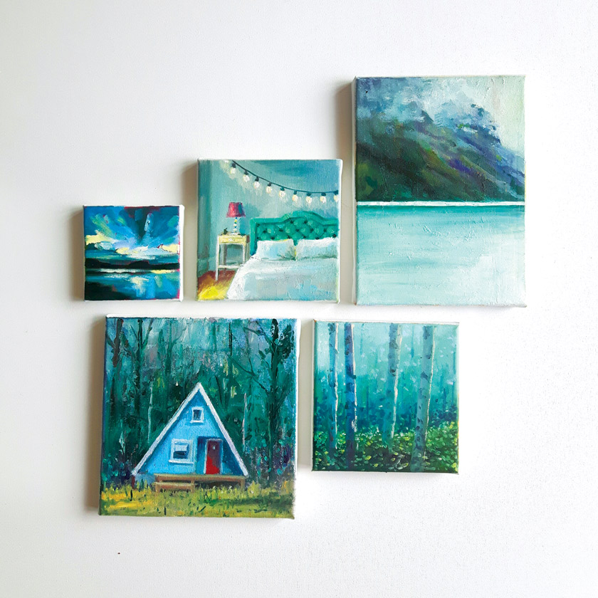 A collection of small blue colored Marleen Kleiberg 's paintings on a white background