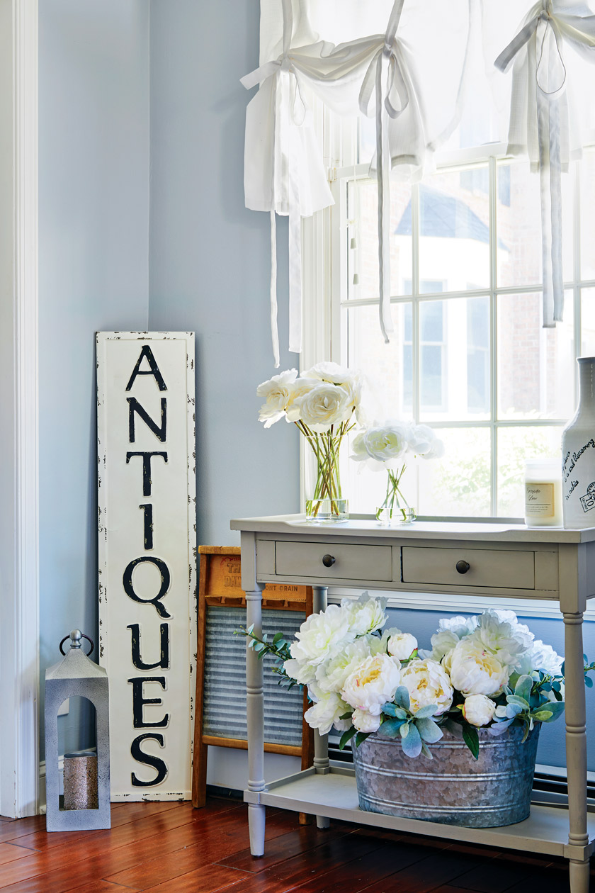 """sunny corner with an """"antiques"""" sign"""