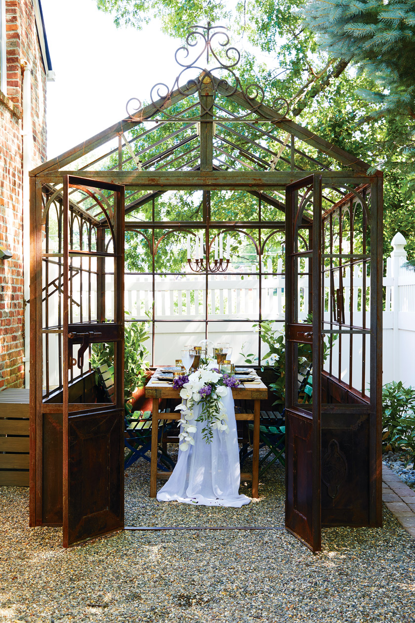 This was a giant iron structure that we found. It's an old greenhouse, and we use it to create kind of an enchanted dining area,