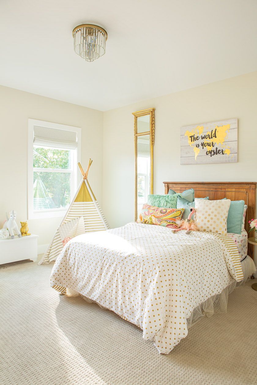 childs bedroom in white, yellow and light blue with a teepee in corner