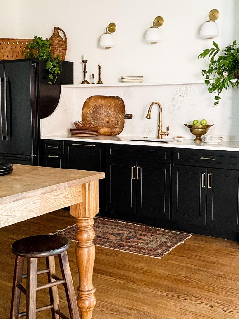 You can't go wrong with a traditional black-and-white pairing. This kitchen takes on a modern edge but maintains its charm.