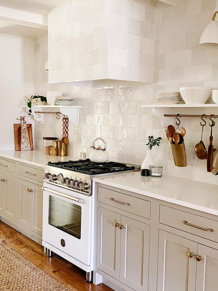 Not everyone likes a white kitchen, and these lower cabinets are the perfect neutral greige.